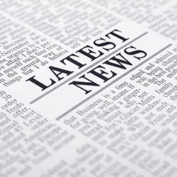 "Stock image of newspaper print with ""Latest News' headline"